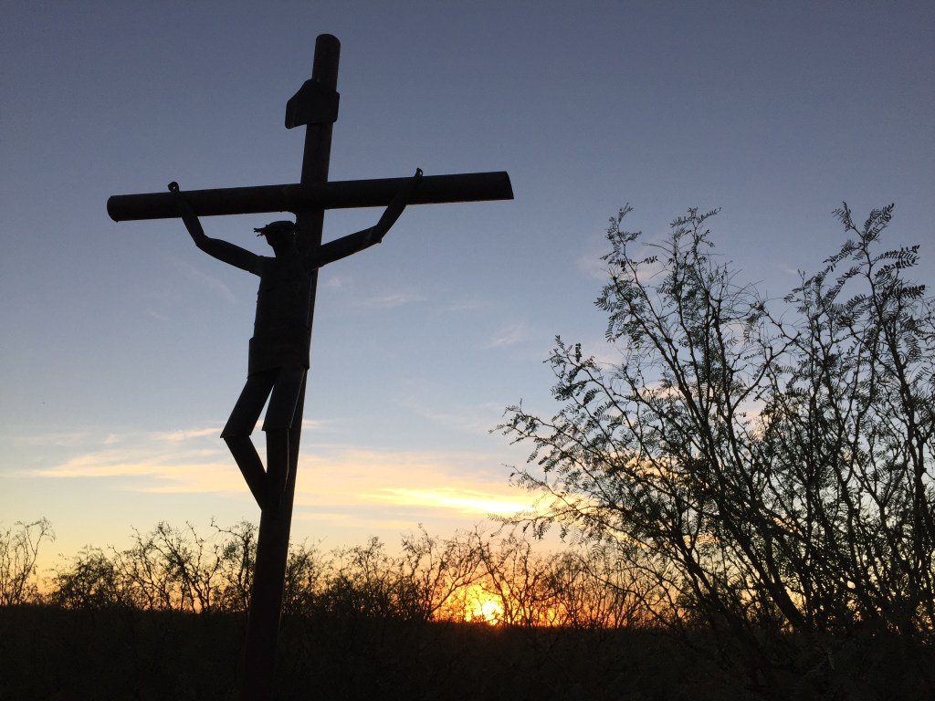 crucifix at sunset