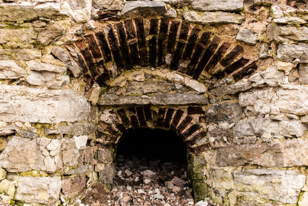Empty window opening in the old wall of an abandoned building.