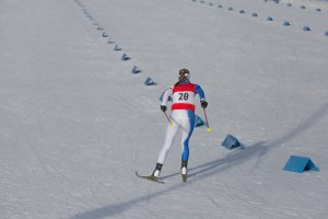 Cross country skiing race, skier rear view