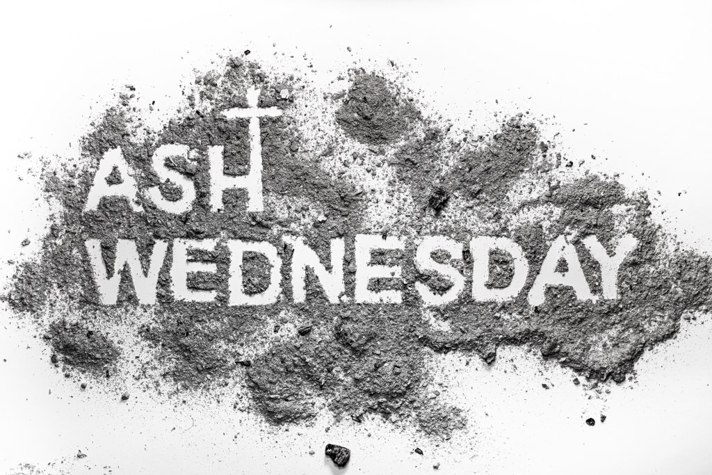 Ash wednesday word written in ash and christian cross