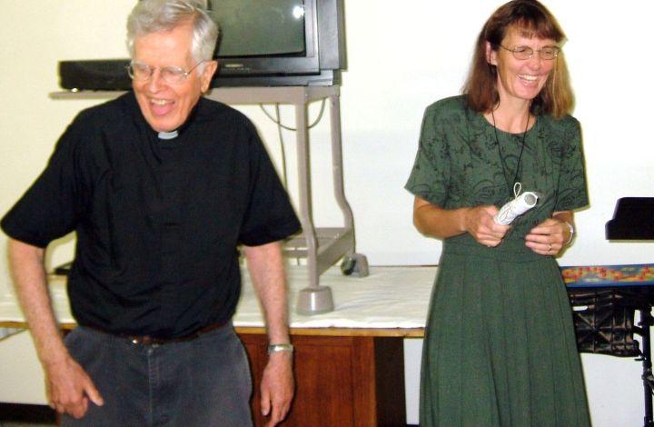 Father Thomas enjoying a laugh