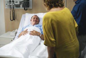 Friends visiting sick man at a hospital