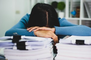 Women experience fatigue due to hard work. The concept of discouragement and fatigue from work.