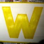 W in yellow