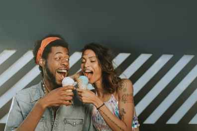 man and woman eating ice creams