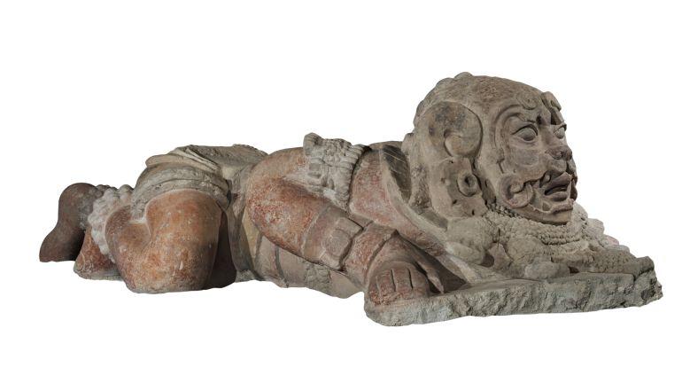 Escultura de hombre jaguar