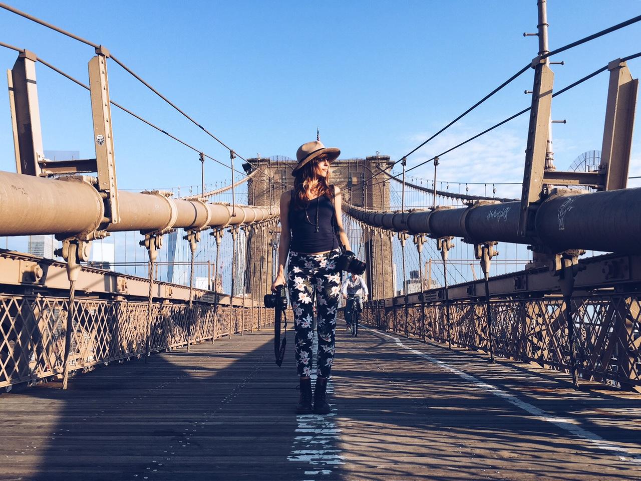 cadence feeley on the brooklyn bridge, new york city