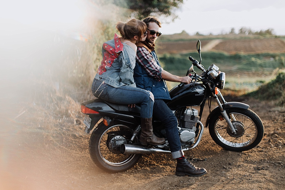 motorcycle couple during couples photography session in maui, hawaii.
