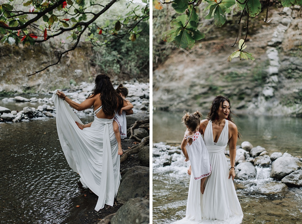 maui photographer takes photos at iao valley for family portraits in maui, hawaii.
