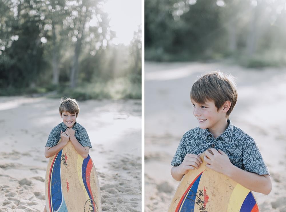 Boy holding Skimboard Baldwin Beach.