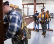 Garret Morgan (center) is training as an ironworker near Seattle and already has a job that pays him $50,000 a year. Sy Bean/The Hechinger Report