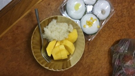 Mango with sticky rice and a snack next to it