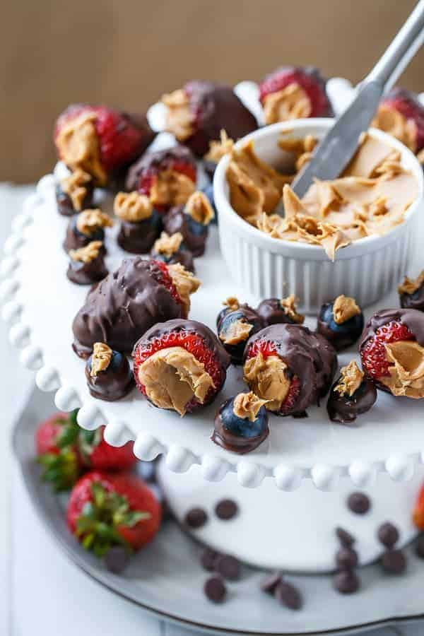 Peanut Butter Stuffed Chocolate Covered Berries | https://cafedelites.com