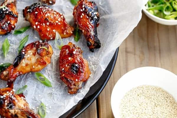 Sticky Honey Sesame Chicken Wings | https://cafedelites.com