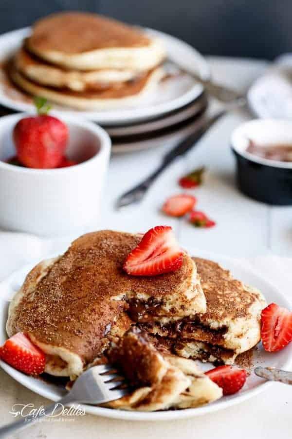 Chocolate and Nutella Stuffed Churro Pancakes | https://cafedelites.com