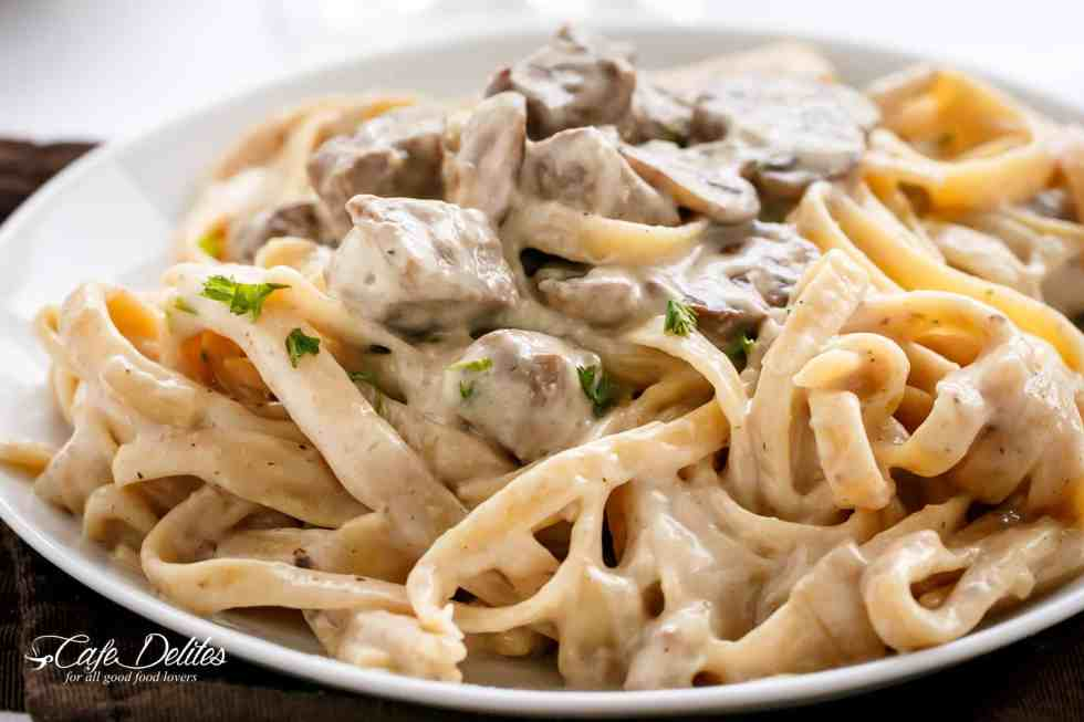 Creamy Beef and Mushroom Stroganoff is the ultimate creamy white wine sauce with steak and mushrooms! | cafedelites.com