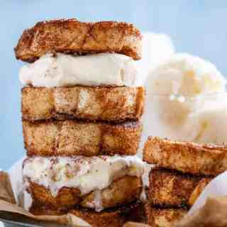 Crispy, buttery Churro french toasts sandwiches with your choice of ice cream or frozen yogurt for one of the best breakfasts ever invented!   http://cafedelites.com