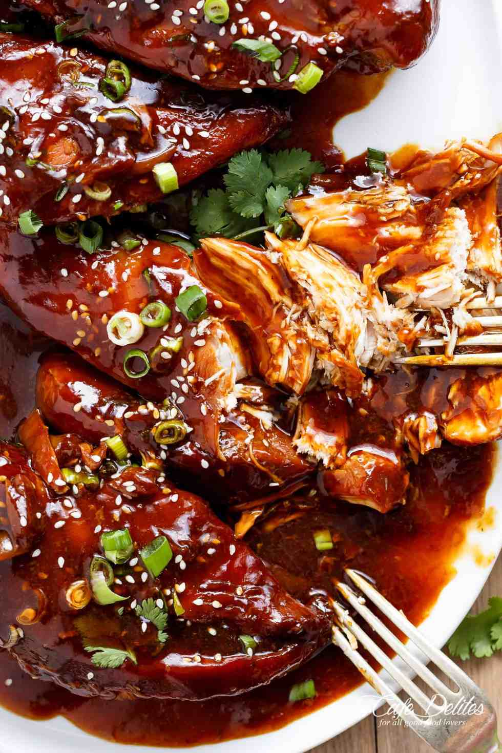 Slow Cooker Asian Glazed Chicken Breasts (or chicken thighs) with honey garlic aromas, perfectly slow cooked and waiting for you when you get home. | cafedelites.com