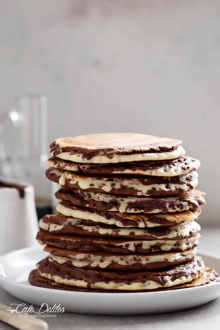 Zebra Marble Pancakes are a step up from normal pancakes and a twist on the popular Zebra cake! Incredibly easy to make AND perfectly fluffy! | https://cafedelites.com