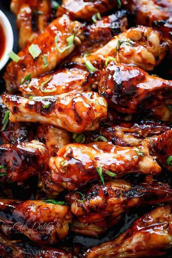 Sticky Thai Chicken Wings glazed with a sticky sauce infused with authentic Thai flavours you most probably already have on hand in the kitchen! | https://cafedelites.com