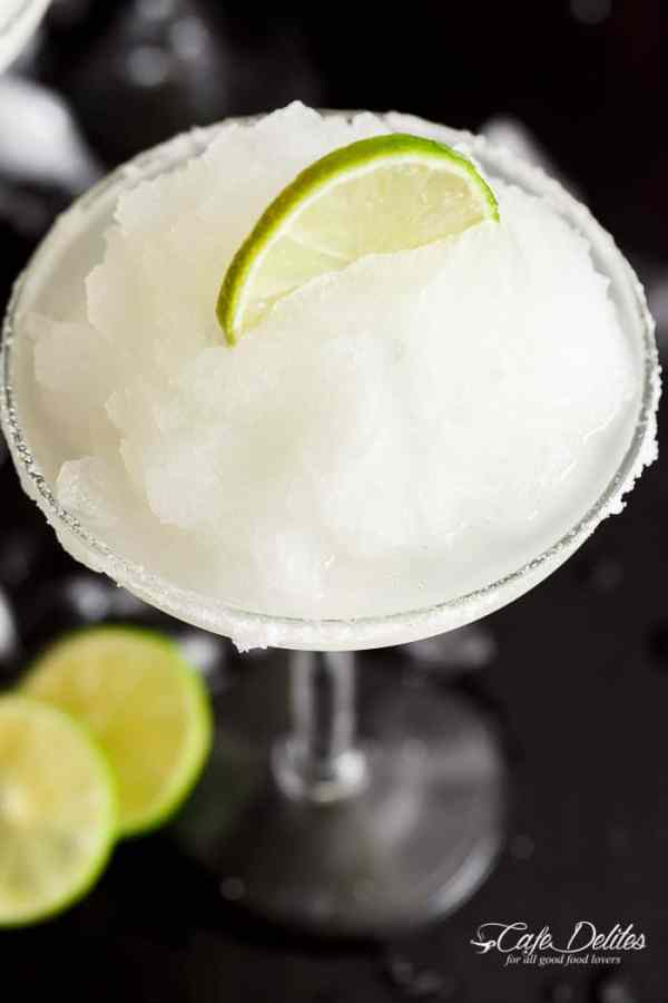 Frozen Margarita Slushy blends the original Margarita made with Tequila and fresh lime juice with ice cubes to make a refreshing icy drink! | https://cafedelites.com