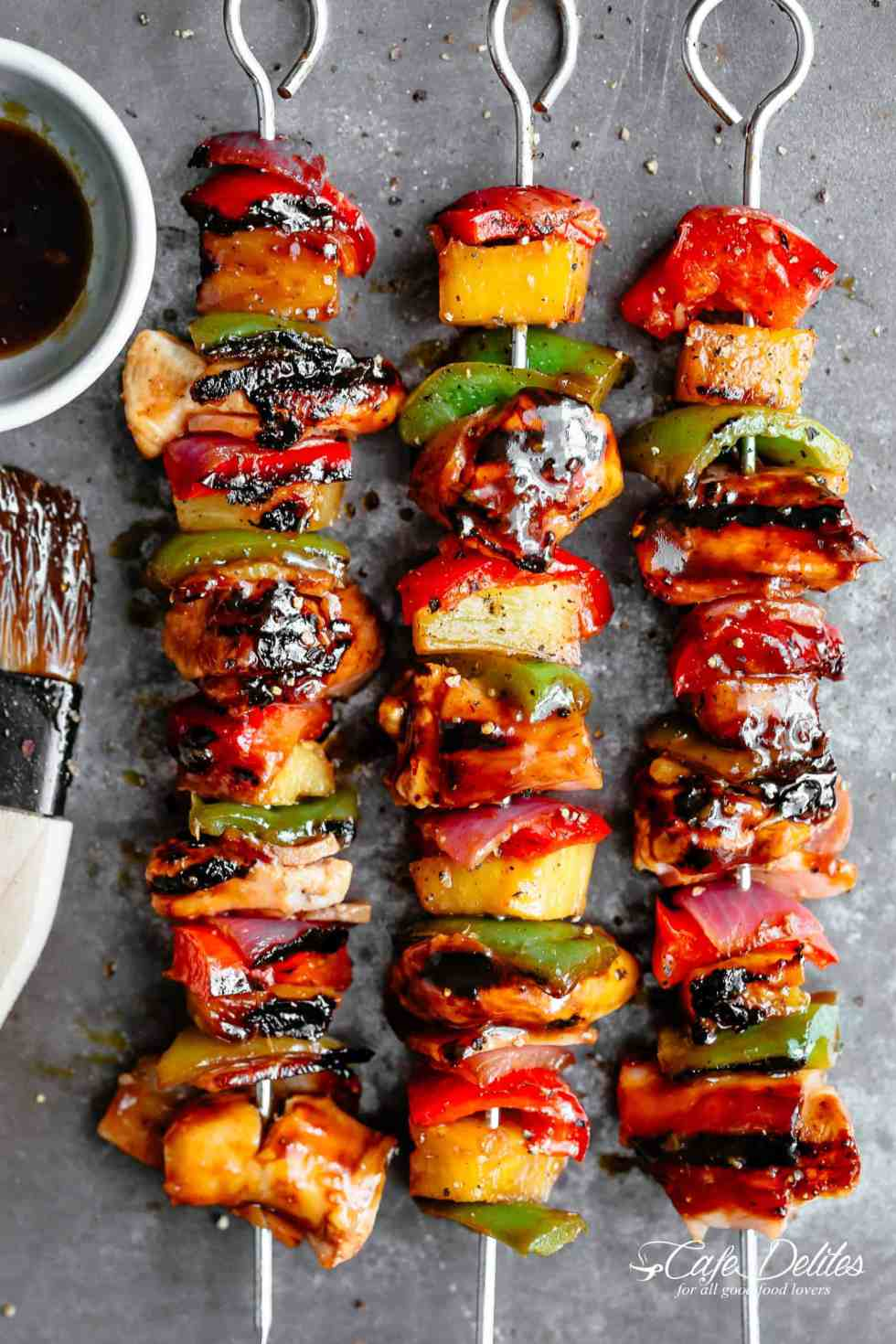 Hawaiian Bacon Pineapple Chicken Kebabs with a BBQ twist! Crispy bacon and chicken smothered in a Hawaiian style pineapple and barbecue sauce, these skewers are so addictive! | https://cafedelites.com