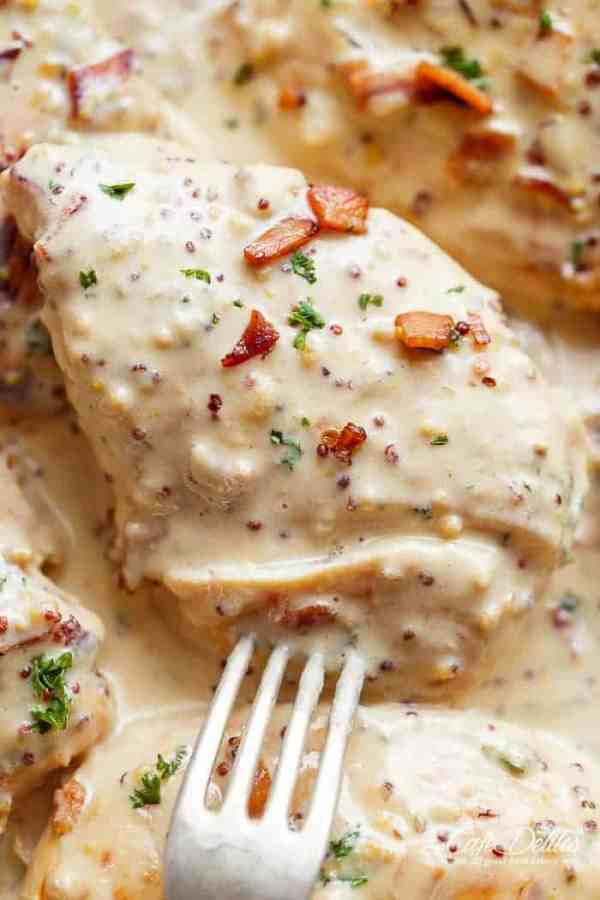 A deliciously Creamy Honey Mustard Chicken with crispy bacon pieces will become your new favourite dinner -- flour less and low carb WITH dairy free options!   https://cafedelites.com