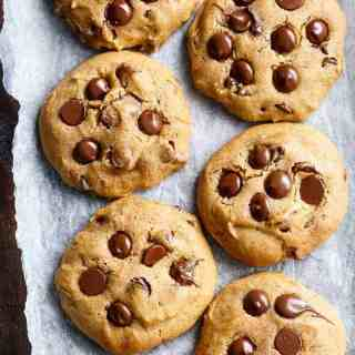 Soft Pumpkin Chocolate Chip Cookies are crispy on the edges and soft and chewy in the centre! The perfect cookie for the season!   http://cafedelites.com