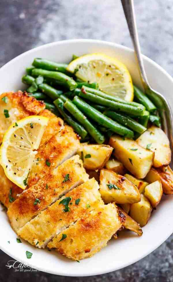 Oven baked and CRISPY breaded Sheet Pan Lemon Parmesan Garlic Chicken & Veggies, complete with potatoes and green beans smothered in a garlic butter sauce! | https://cafedelites.com