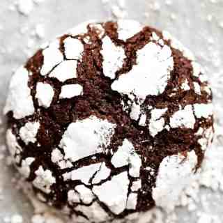 Fudgy Chocolate Crinkle Cookies have an irresistible brownie textured centre, with a crunch of cookie on the outside! One of our favourite Christmas cookies right here! ONLY 88 calories EACH!   http://cafedelites.com