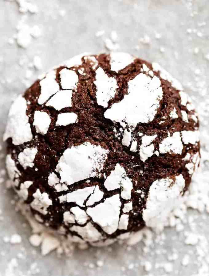 Fudgy Chocolate Crinkle Cookies have an irresistible brownie textured centre, with a crunch of cookie on the outside! One of our favourite Christmas cookies right here! ONLY 88 calories EACH! | http://cafedelites.com