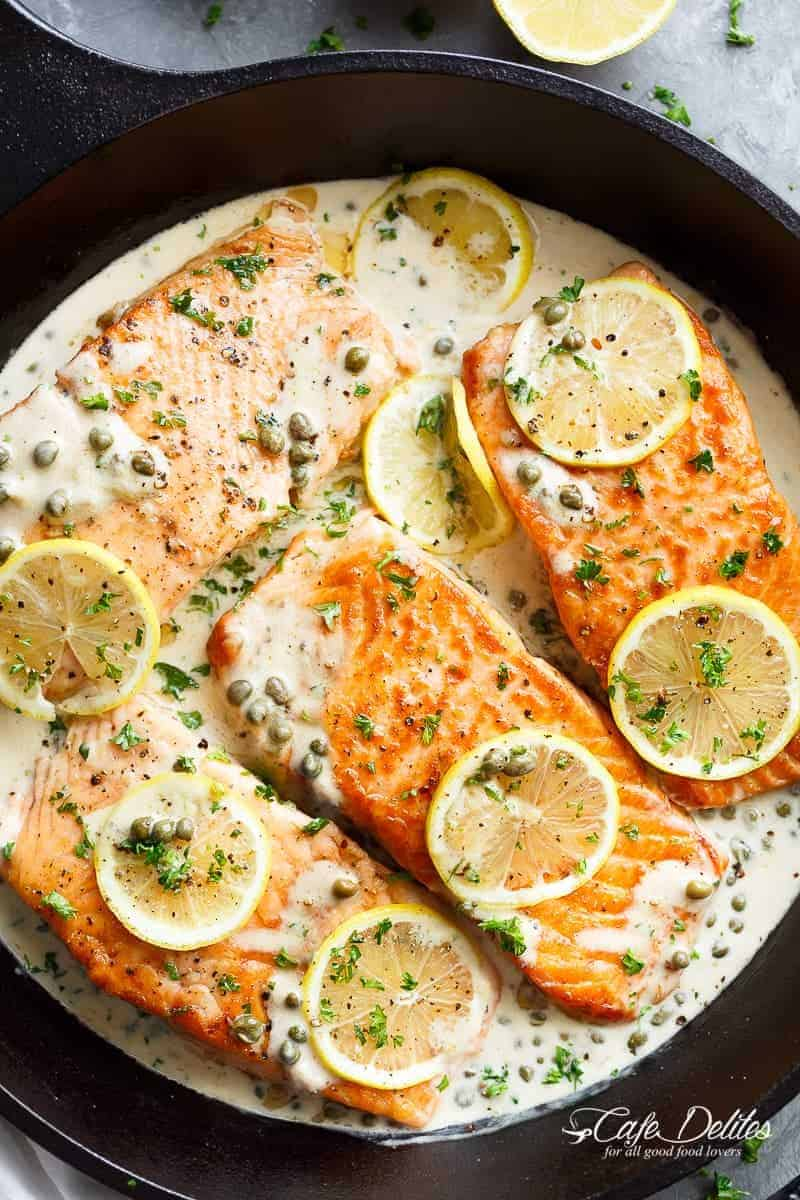 Creamy Lemon Garlic Salmon Piccata is a classy yet easy salmon recipe you've been waiting for, with a delicious creamy lemon caper sauce!   https://cafedelites.com