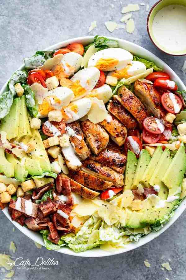 Grilled Chicken Cobb Caesar Salad is a meal in a salad, merging two of your favourites into one delicious bowl! Perfect for lunch or dinner! | https://cafedelites.com