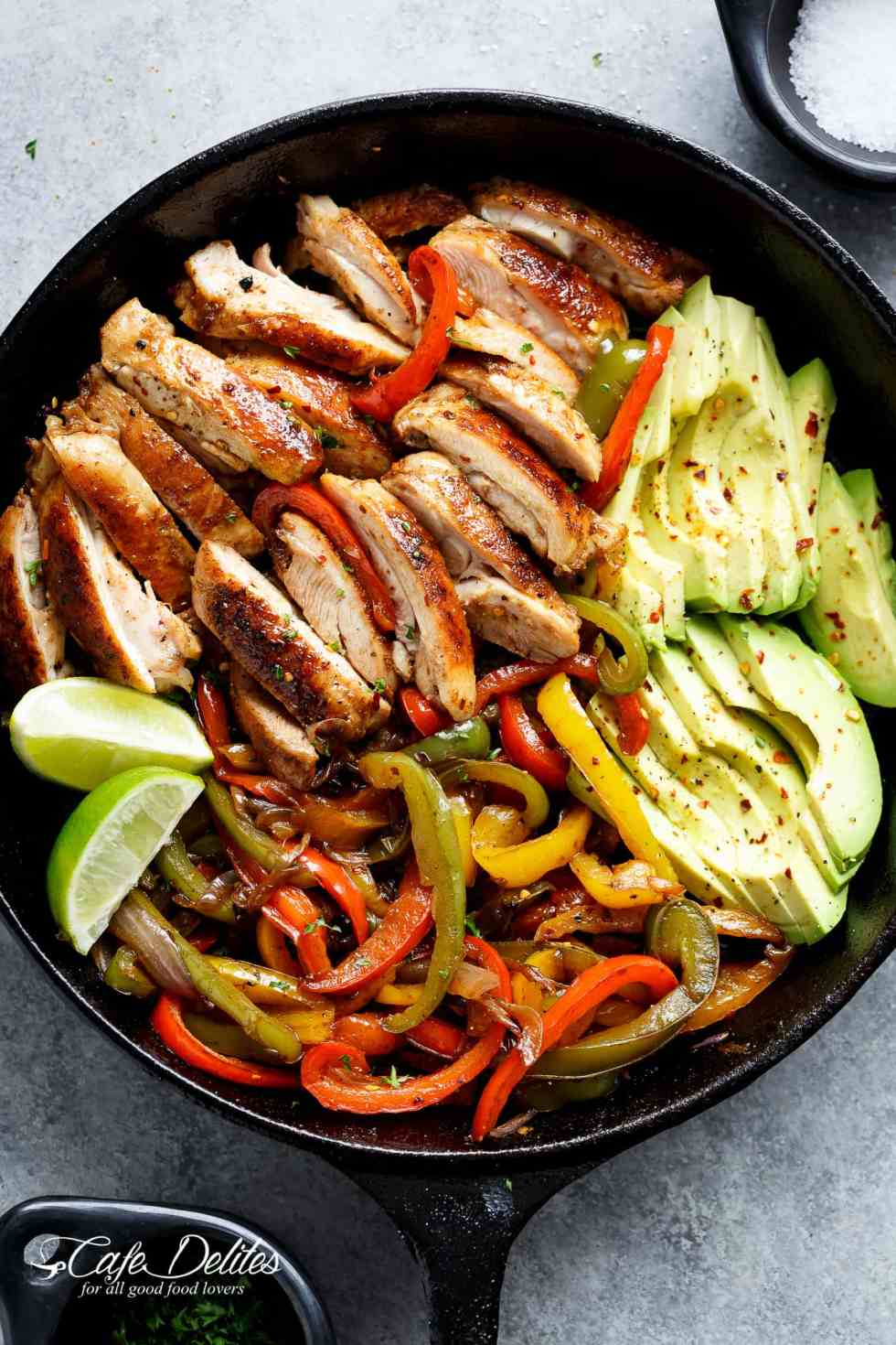 Best Chicken Fajitas are quick to throw together! Chicken gets marinated in the best juicy lime marinade, then seared for that unmistakeable crisp-charred outer edge! Serve with onions and bell pepper strips! | cafedelites.com
