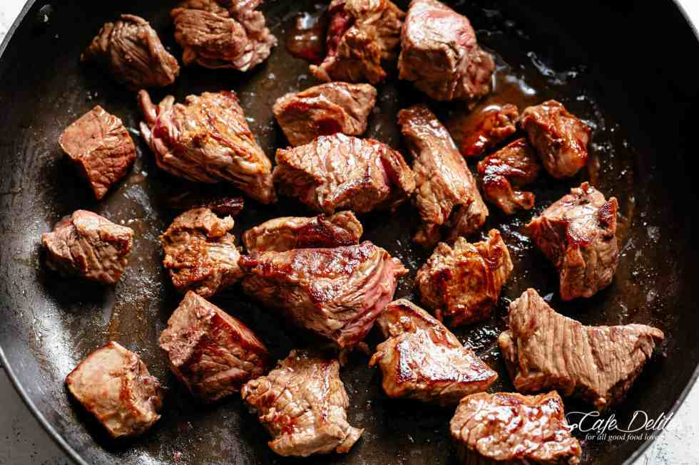 Tender fall apart chunks of beef simmered in a rich red wine gravy makes Julia Child's Beef Bourguignon an incredible family dinner. Slow Cooker, Instant Pot/Pressure Cooker, Stove Top and the traditional Oven method included! Easy to make, every step is worth it   cafedelites.com