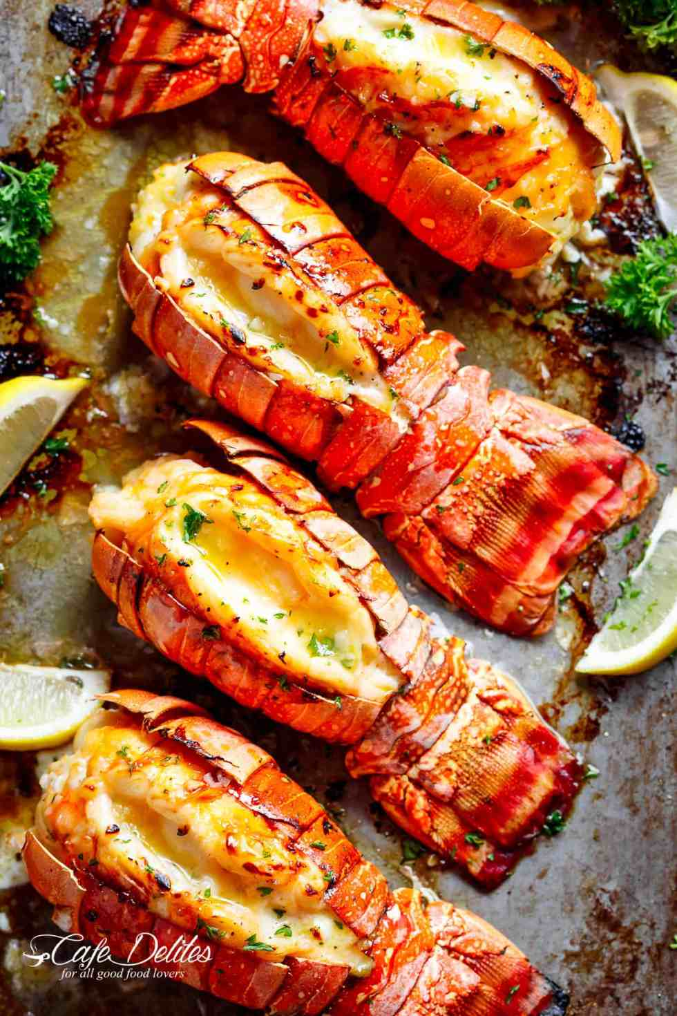 Broiled Lobster Tails with Honey Garlic Butter White Wine Sauce is a fancy, classy and best of all EASY to make recipe. Ready in under 20 minutes, let the oven do all the cooking for you! | cafedelites.com