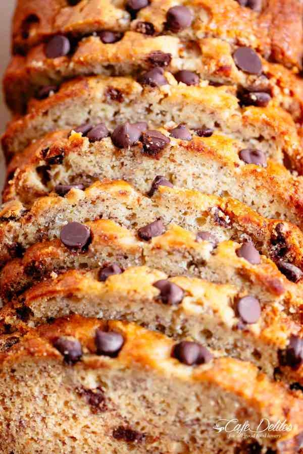 The Best Fluffy Banana Bread with chocolate chips or chopped nuts is not only the best way to use up over-ripe bananas, but it's possibly the best slice to go with your morning coffee! Better than anything store-bought, our banana bread is buttery, moist and smells amazing while baking! Every bite is pure heaven! | cafedelites.com