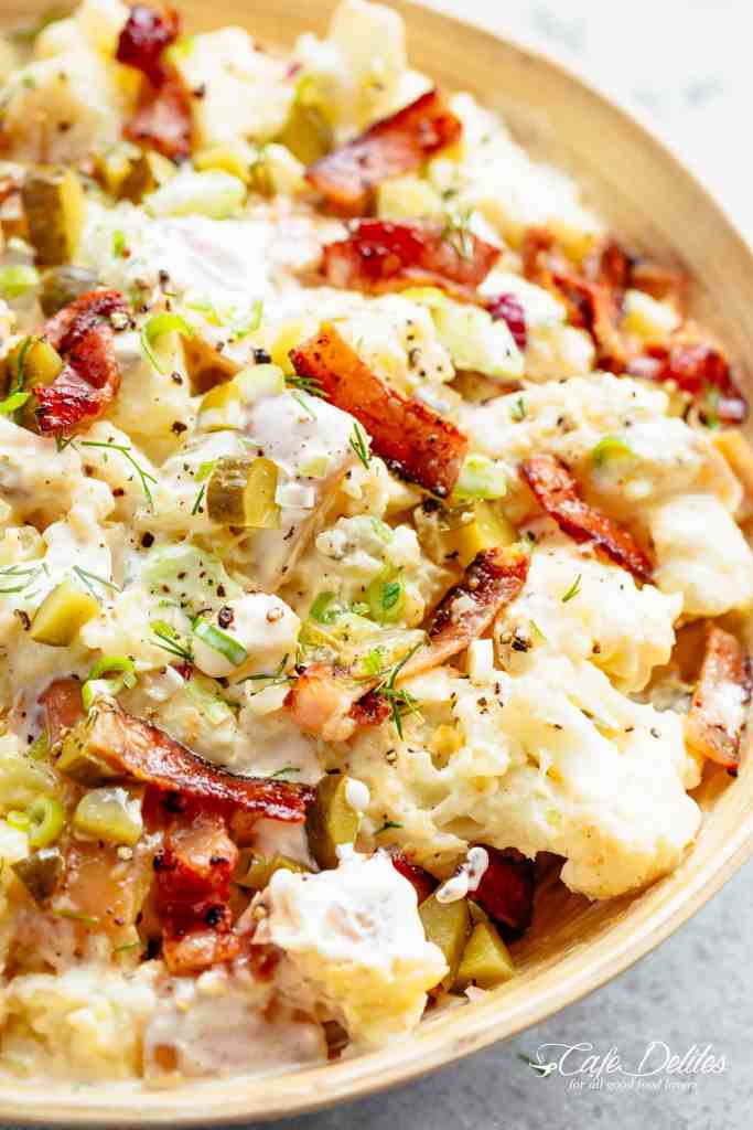 Potato Salad with Bacon, Dill Pickles, Eggs, HALF the carbs AND a creamy mayo/sour cream dressing! This Potato Salad is THE BEST side dish! HALF of the carbs of regular potato salads with SO MUCH FLAVOUR! The recipe also includes LOW CARB AND ALL CARB OPTIONS! | cafedelites.com