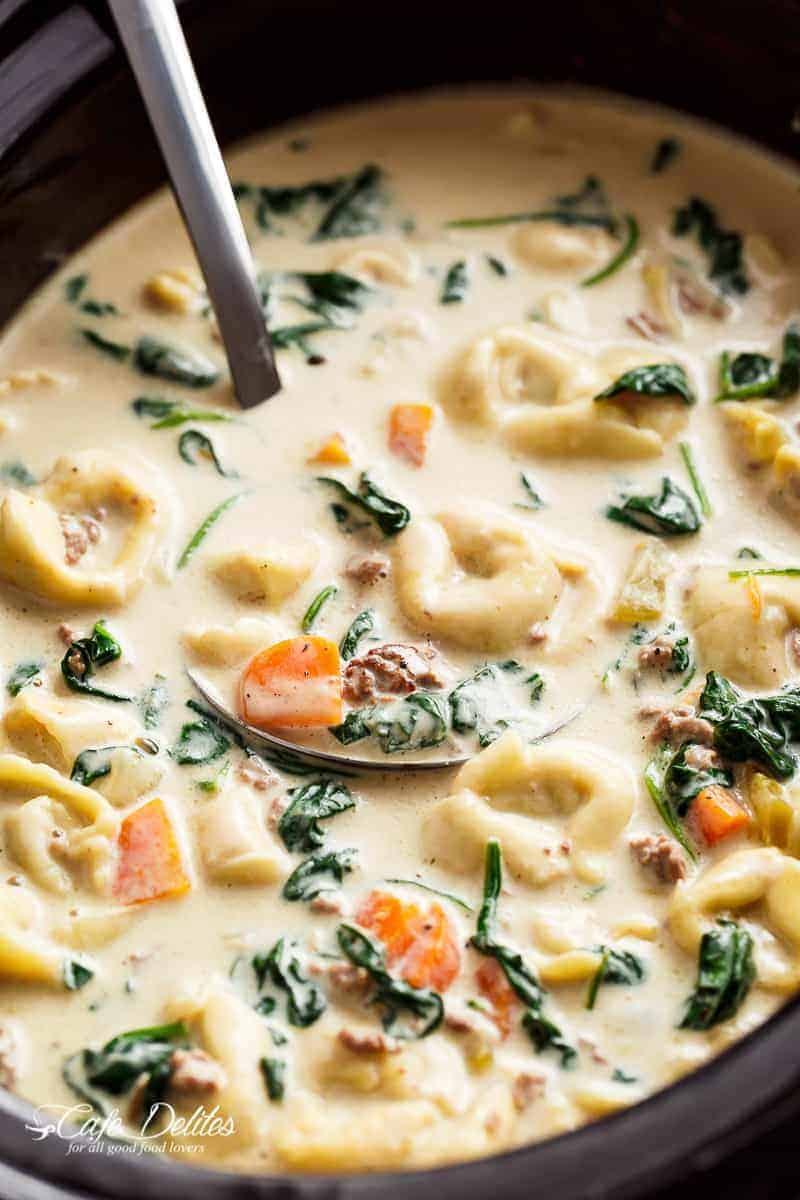 Slow Cooker Creamy Tortellini Soup is pure comfort food, loaded with vegetables, Italian sausage and cheese tortellini! NO flour and NO heavy cream!   https://cafedelites.com