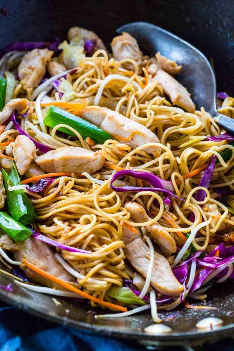 Wok spatula mixing chicken chow mein