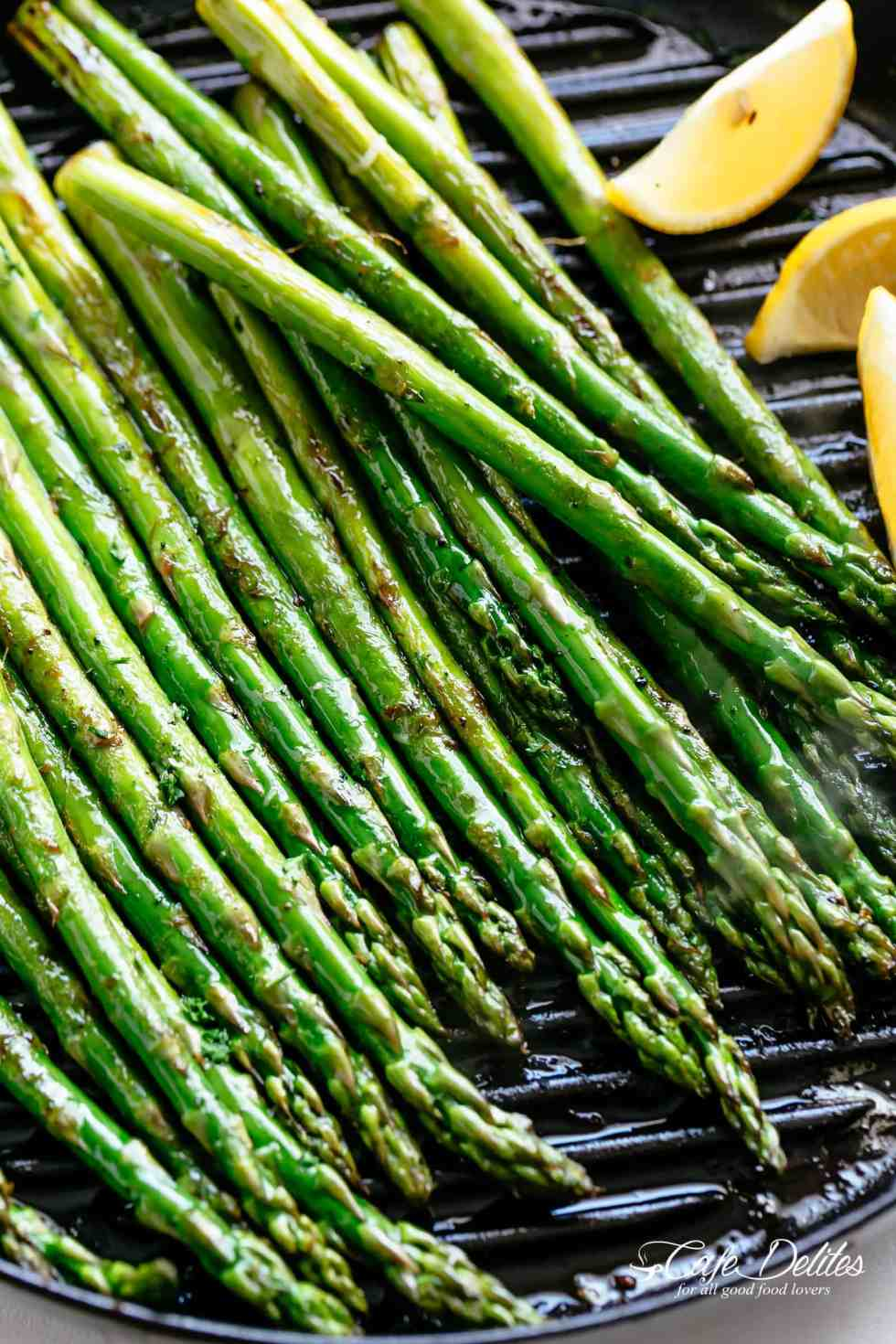 Grilled Asparagus takes minutes! Simply toss in olive oil and garlic, season with salt and pepper and throw them directly on the grill! | cafedelites.com