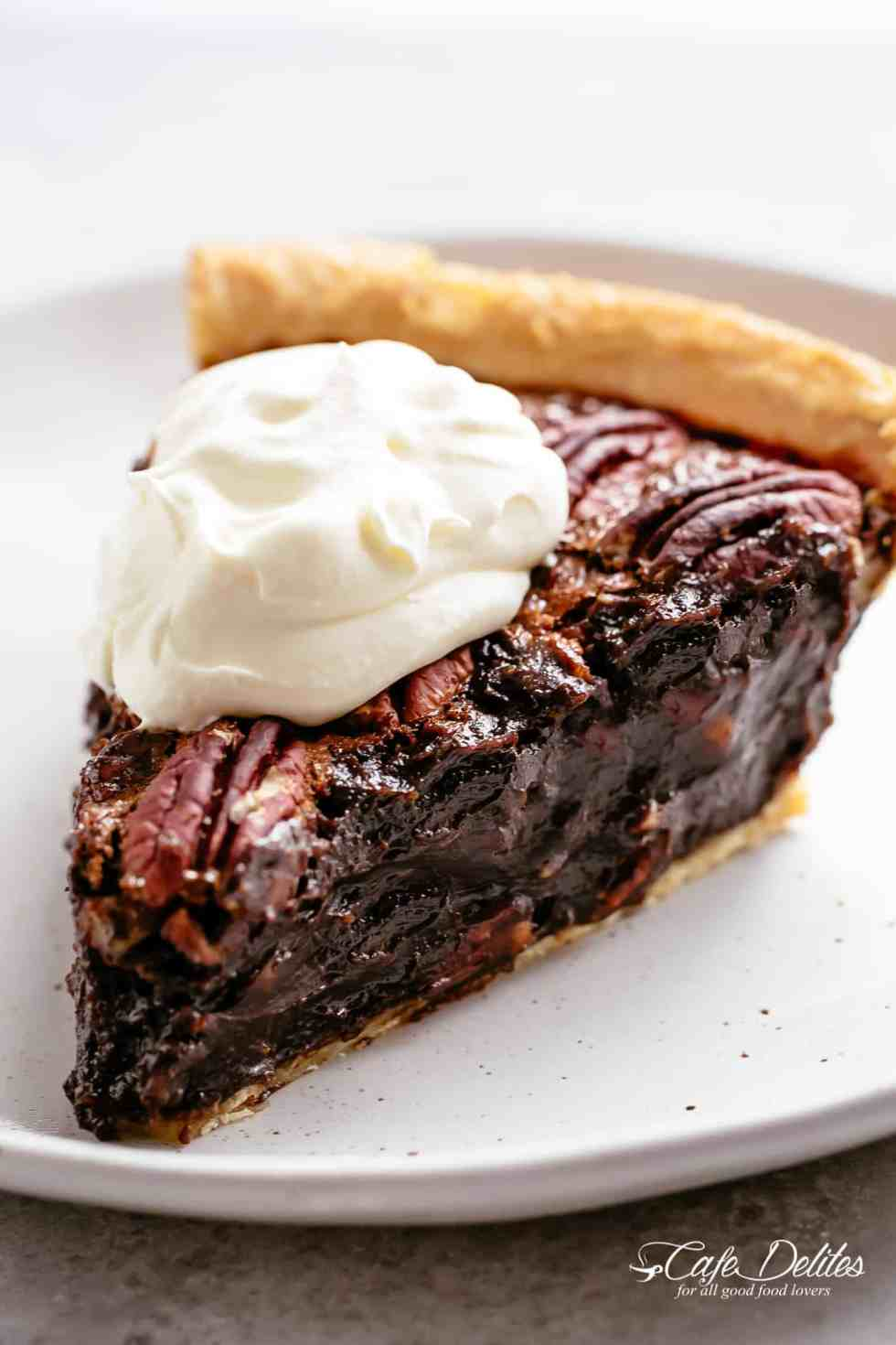 A slice of pecan pie with whipped cream