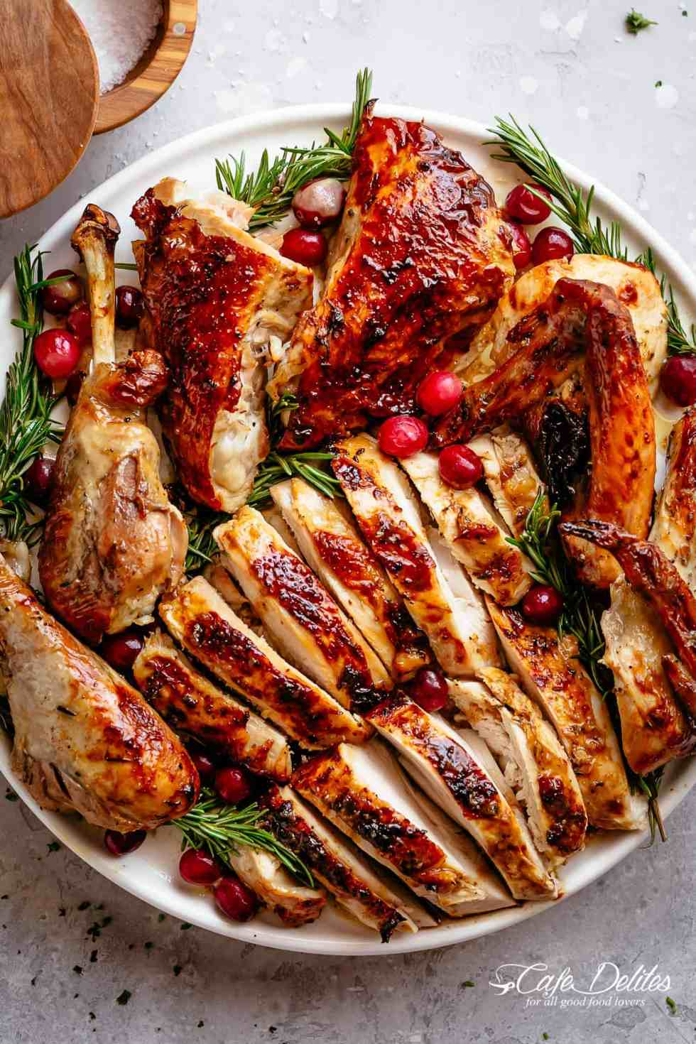 Garlic Herb Butter Roast Turkey recipeis succulent and tender on the inside with a golden, buttery skin and so much flavour! | cafedelites.com