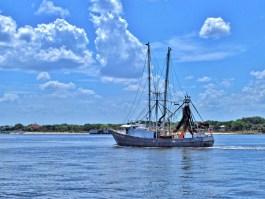 Shrimp Boat Heading to Sea