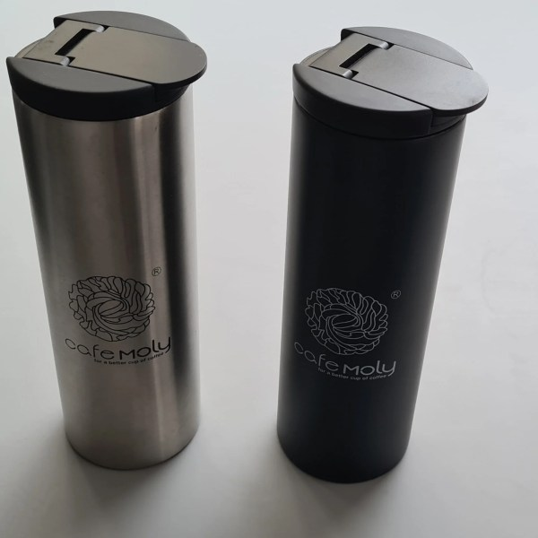 Black and Silver Thermos flasks. One silver and one black. View as standing.