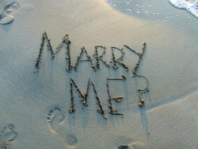 marry me written on sand