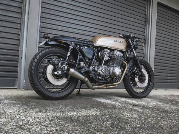 By @haywirecycles -  Custom 4 into 1 stainless exhaust with longer rear shocks make for a more aggressive stance  #honda #cb750 .  #caferacer #caferacers #caferacerstyle #caferacersculture #caferacerbuilds #vintage #vintagestyle #vintagefashion #motocycle #moto #motos #motorcycles #oldstyle #oldschool #bratstyle #motorbike #motor #helmet