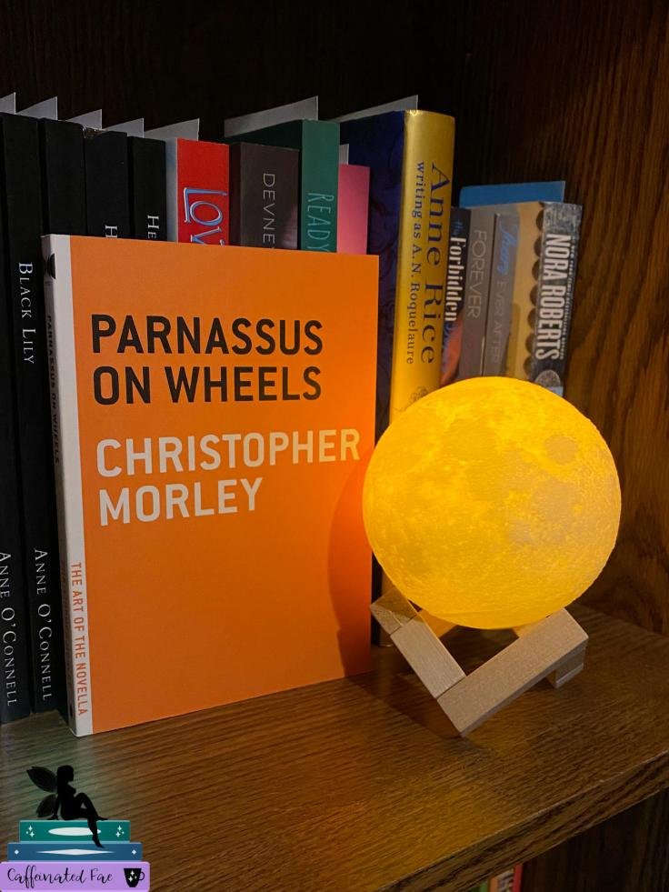 Picture of Parnassus on Wheels by Christopher Morley next to a moon lamp.