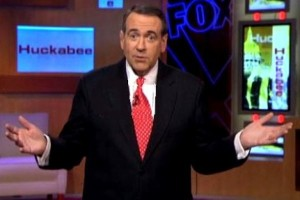 "Mike Huckabee raises his hands as if to say ""Who me?"""