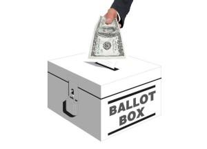 A Hand placing a $100 bill in Ballot Box